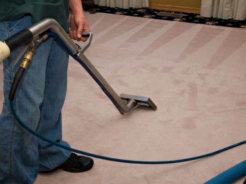 professional-cleaner-cleaning-carpet-cost-vacuum